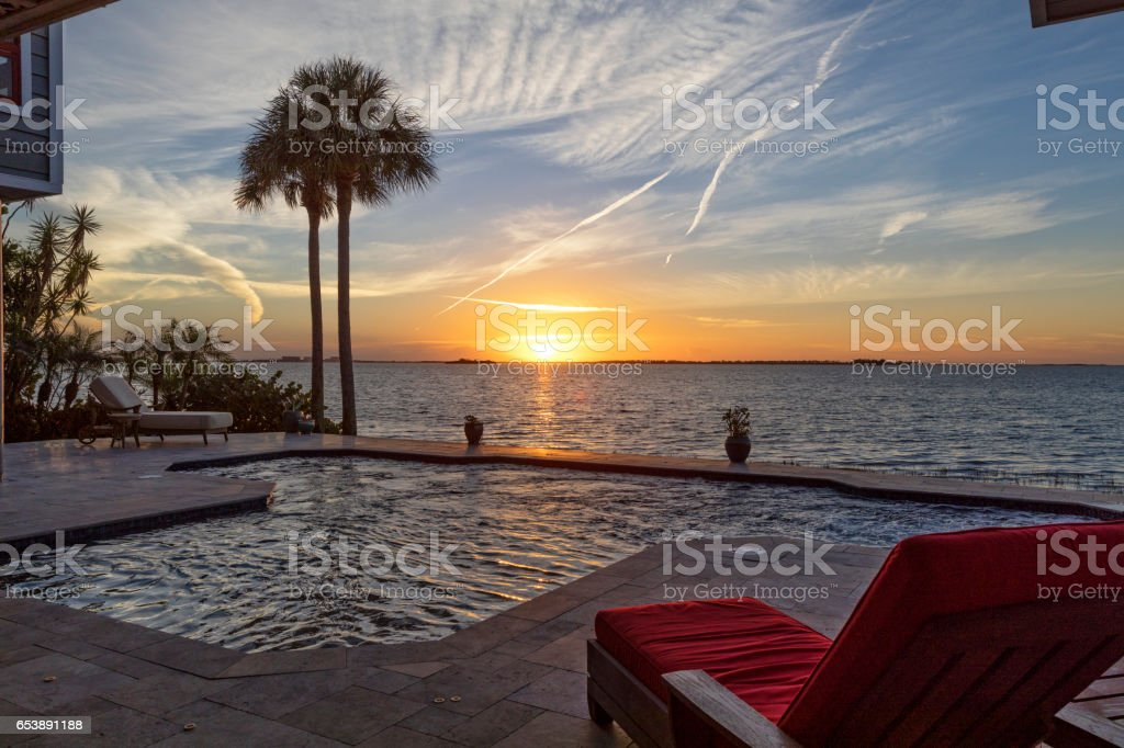 Beautiful Evening by the Swimming Pool in Tropical Setting stock photo