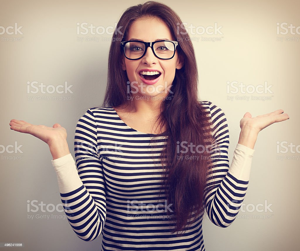 Beautiful excited woman in glasses with natural surprising stock photo
