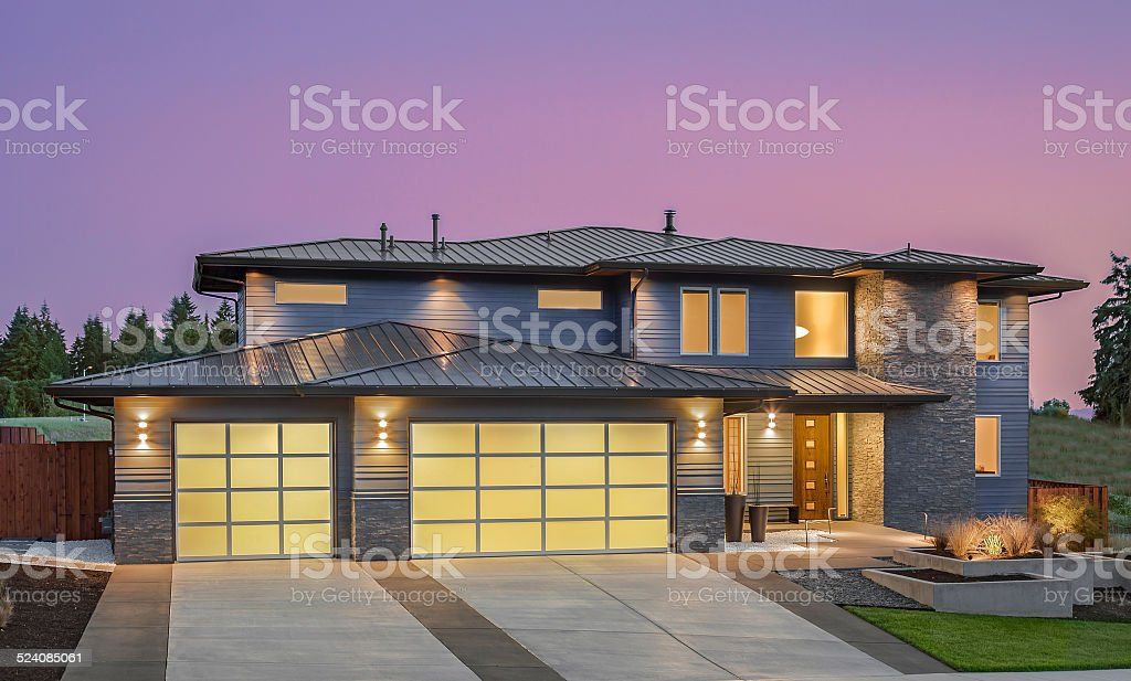 Beautiful Exterior of New Luxury Home at Twilight stock photo