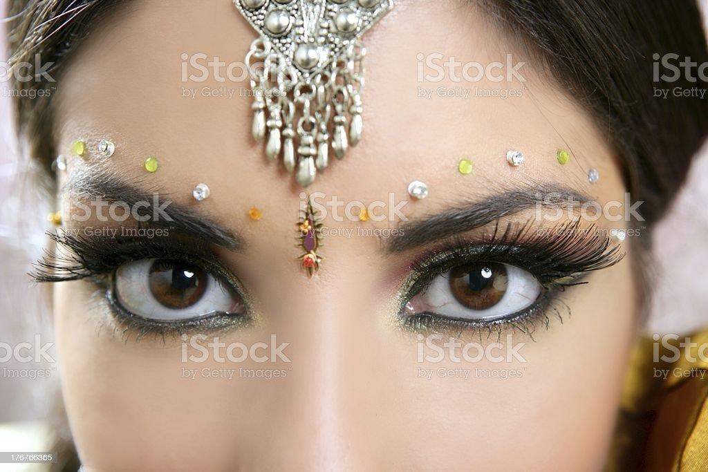 Beautiful eyes closeup indian brunette woman portrait stock photo