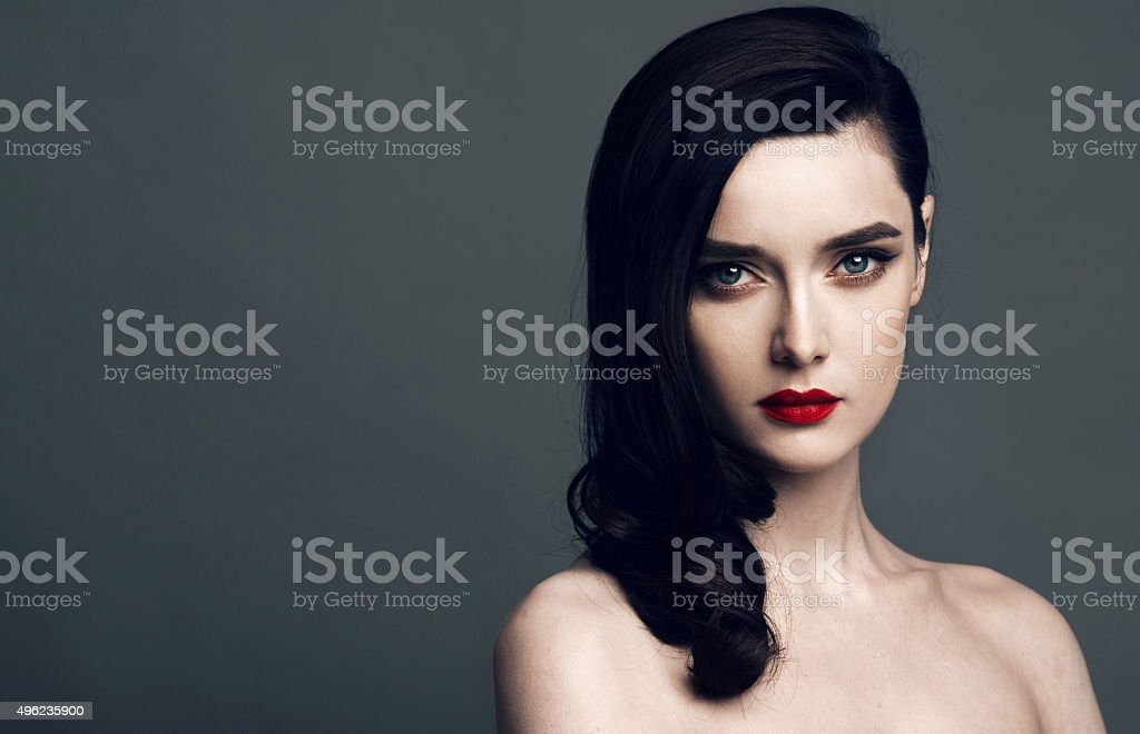 Beautiful face of a glamour woman with bright make up stock photo