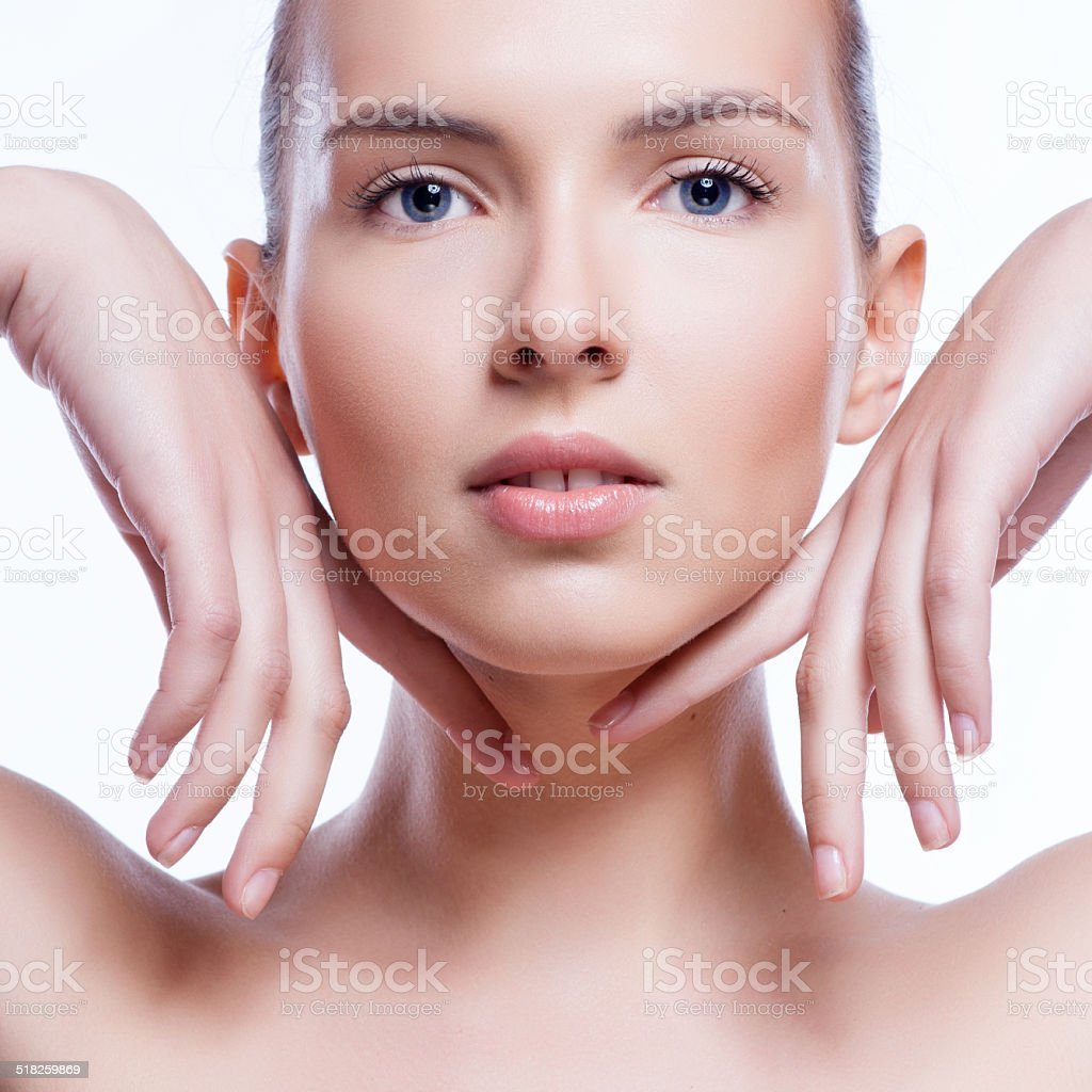 Beautiful face of young adult woman with clean fresh skin stock photo