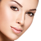 Beautiful face of young woman with health fresh skin