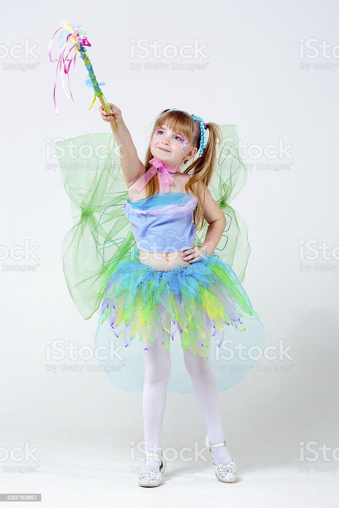 Beautiful fairy waving wand stock photo