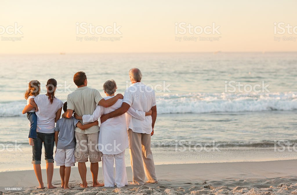 Beautiful family at the beach stock photo