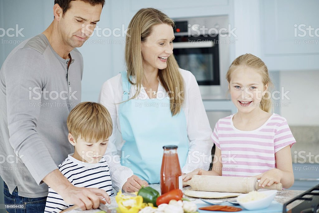 Beautiful family cooking pizza royalty-free stock photo