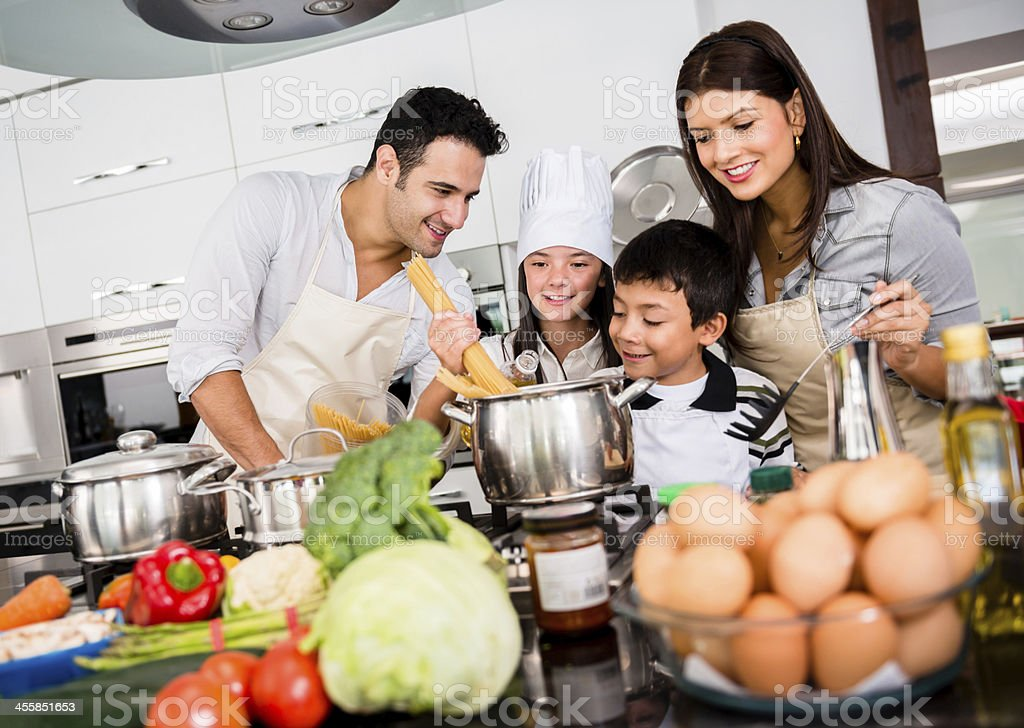 Beautiful family cooking together stock photo