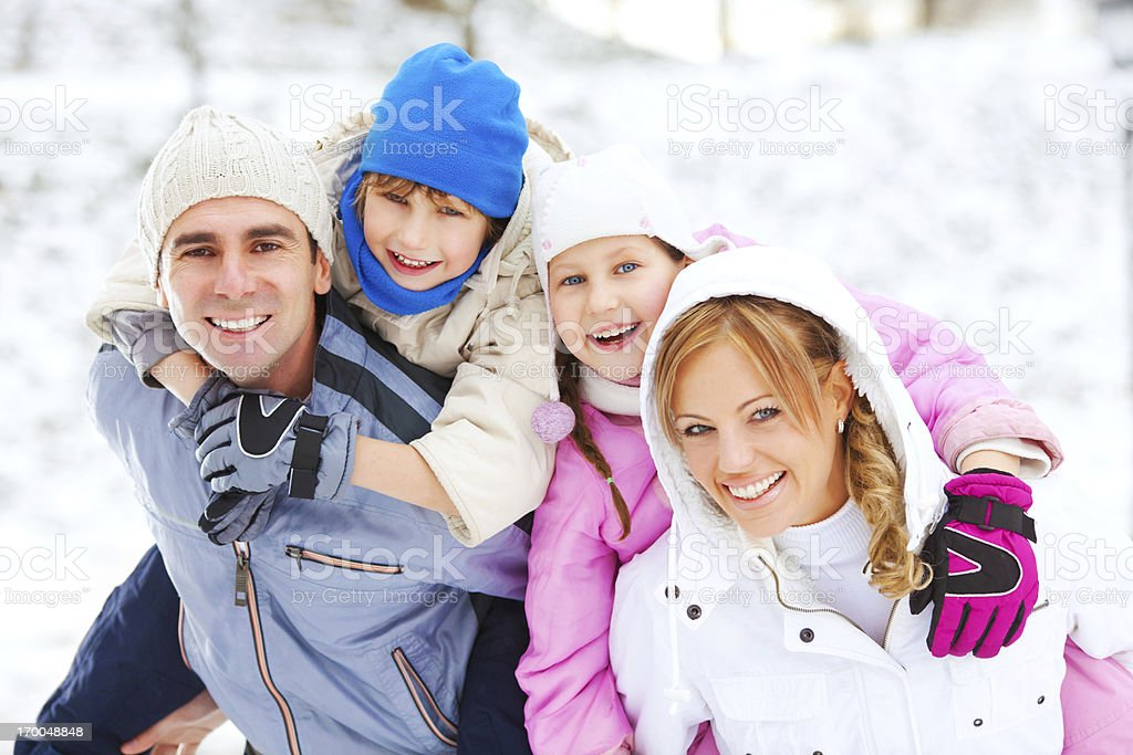 Beautiful family enjoying in snow and winter. royalty-free stock photo