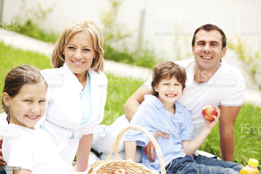 Beautiful family having a picnic i the nature. royalty-free stock photo