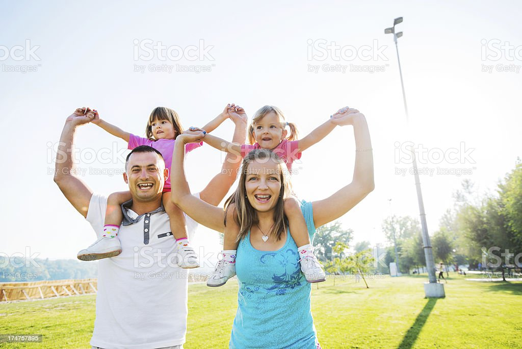 Beautiful family having fun outdoors. royalty-free stock photo