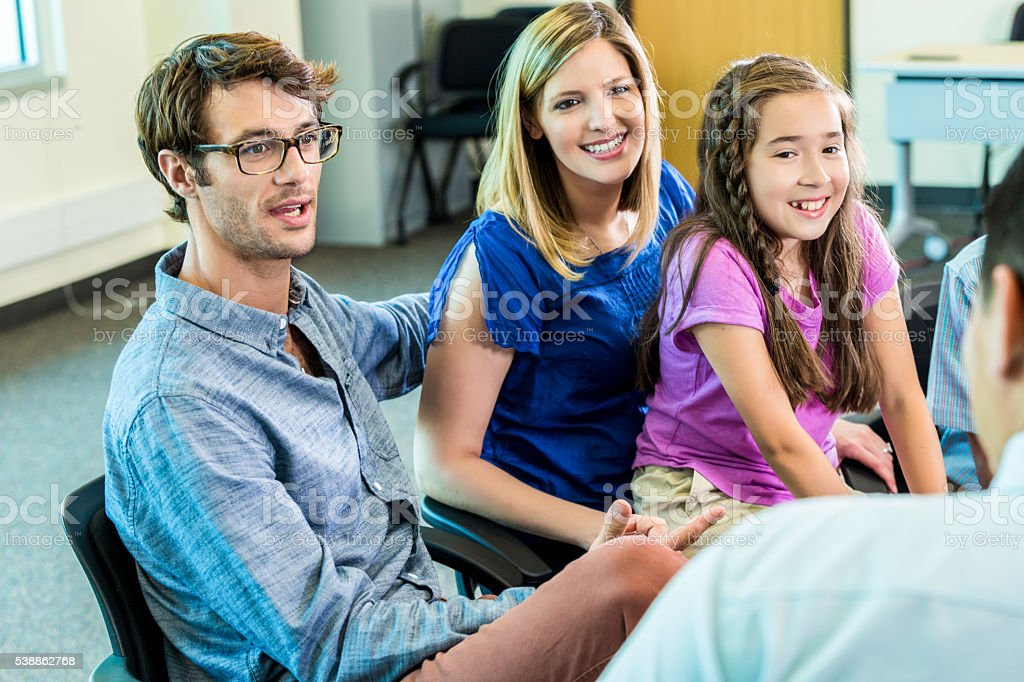 Beautiful family meet with teacher stock photo
