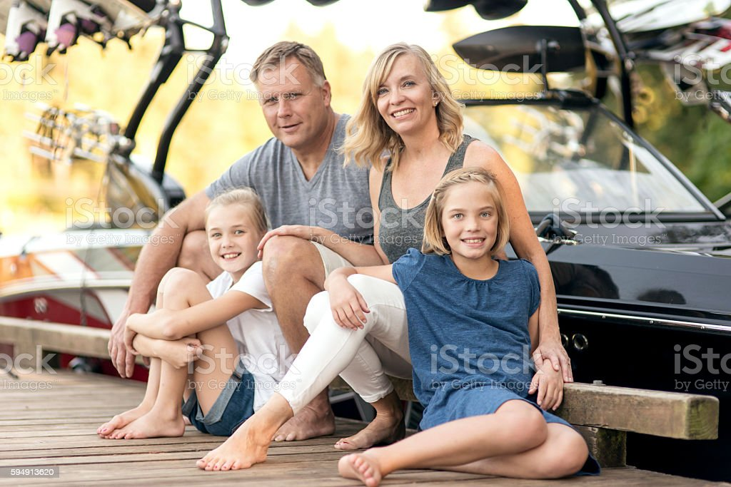 Beautiful family ready for a day on the lake stock photo