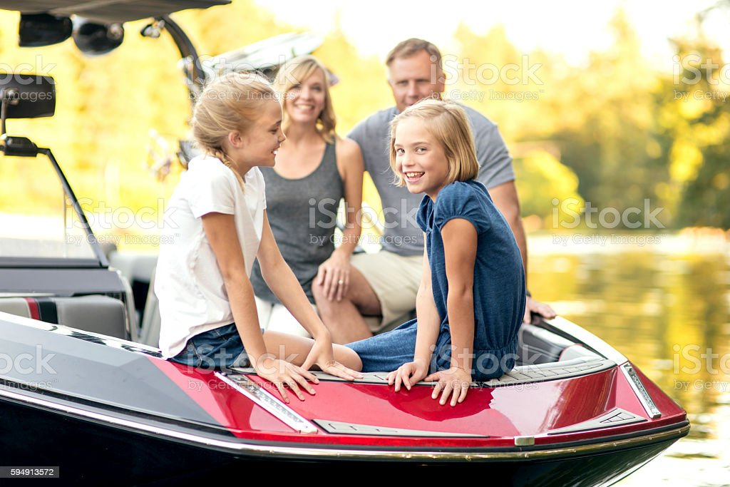 Beautiful family sitting in the front of their competition stock photo