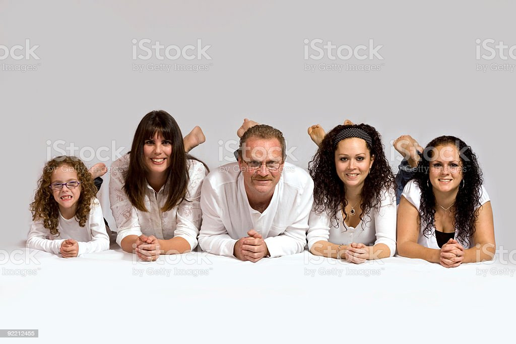 Beautiful family together on floor stock photo