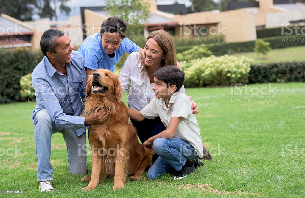 Beautiful family with a dog stock photo