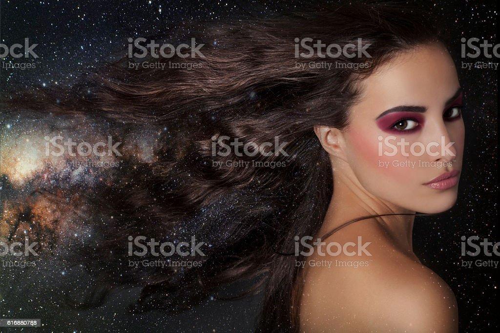 beautiful fantasy woman among stars stock photo