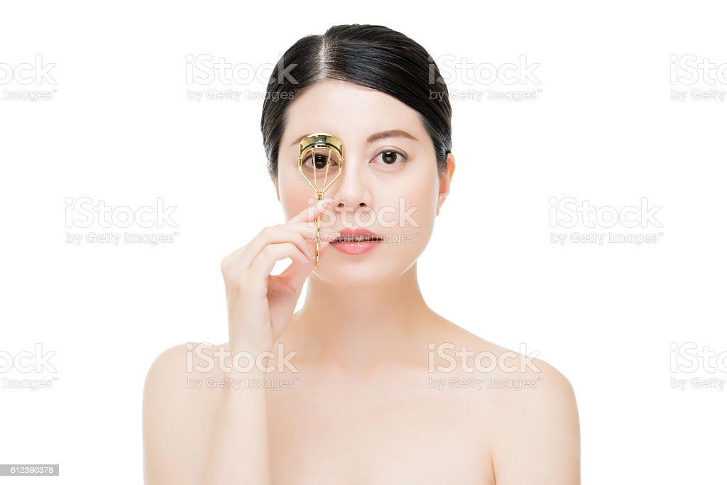 beautiful fashion girl holding eyelash curler makeup accessory stock photo