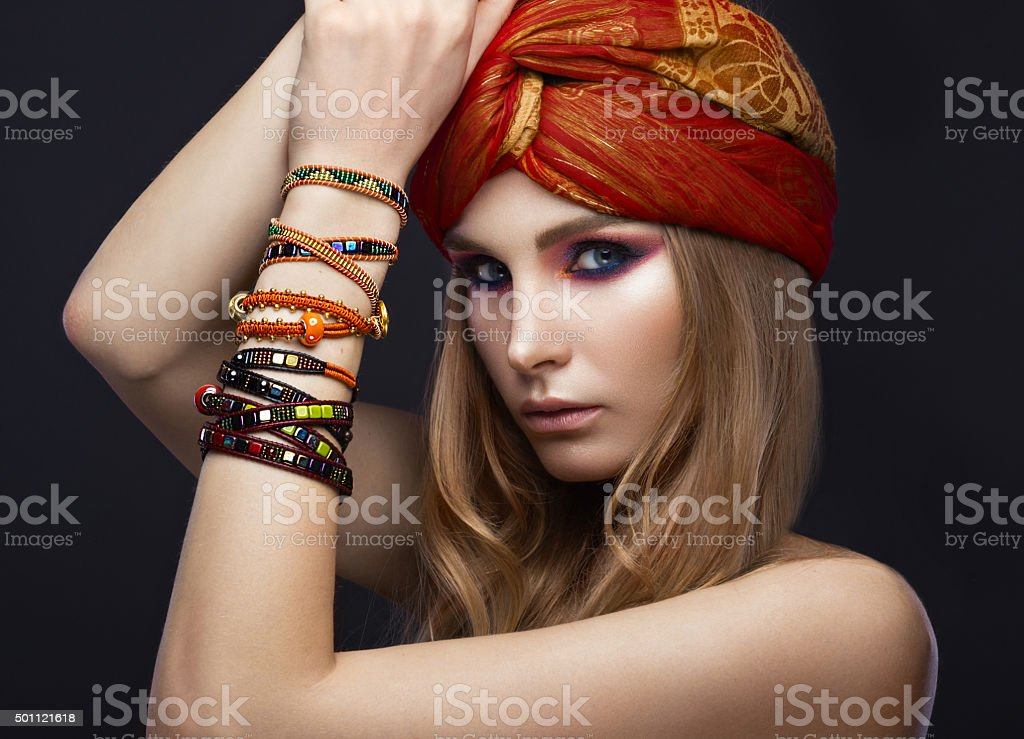 Beautiful fashion girl in a scarf and bracelets boho style stock photo