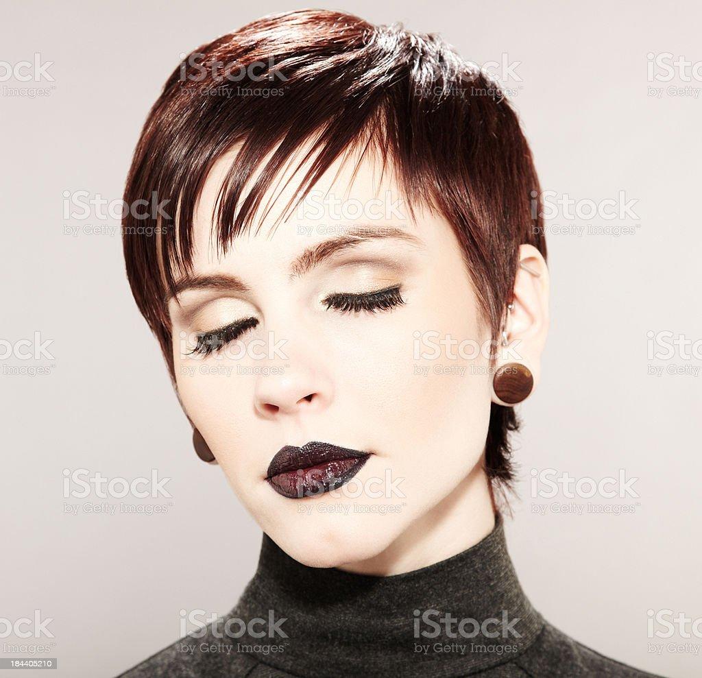 Beautiful fashion model black lipstick and dramatic short hairstyle stock photo