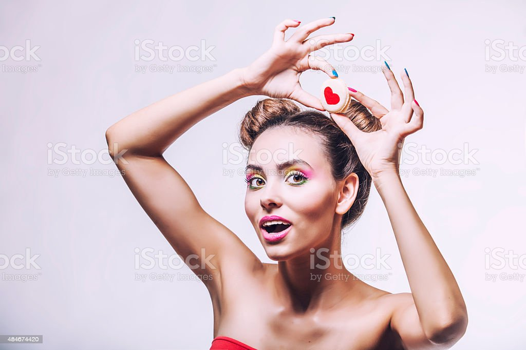 Beautiful fashion model girl with cookies with hearts stock photo