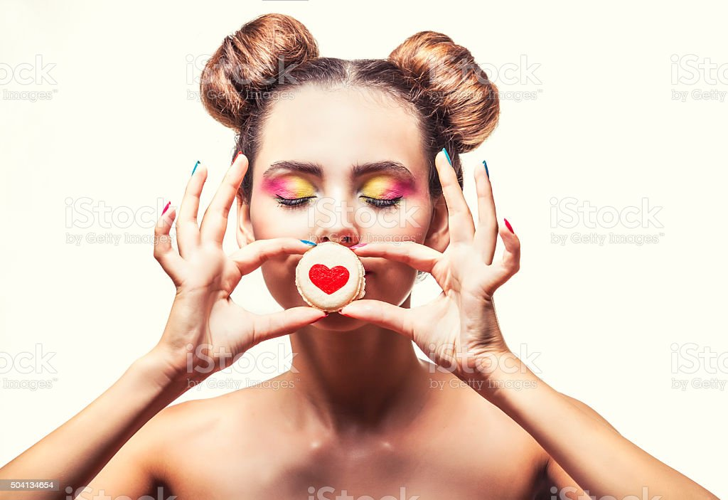 Beautiful fashion model girl with sweet cookies with hearts stock photo