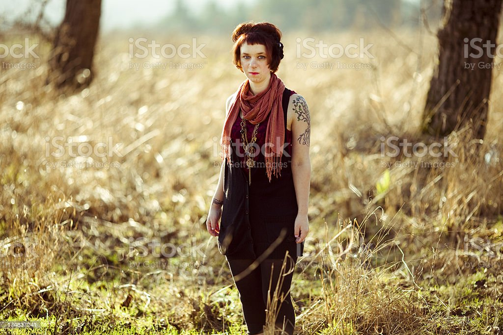 Beautiful Fashion Model Hipster Young Woman in Nature royalty-free stock photo