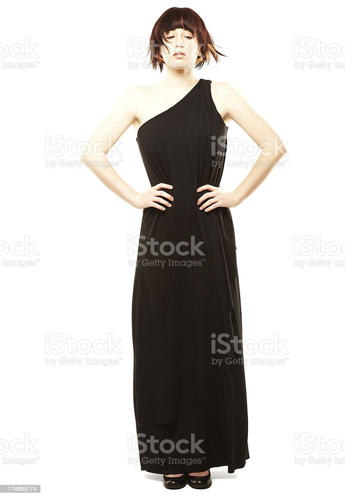 Beautiful fashion model in black posing with Hands on Hips stock photo