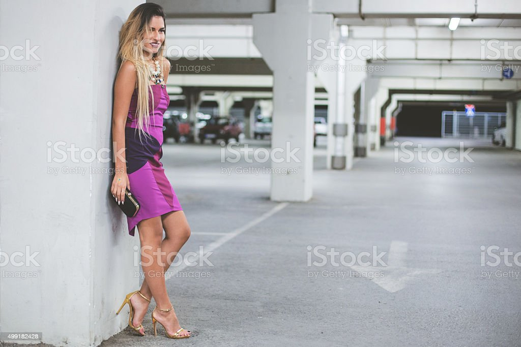 Beautiful fashion model posing in parking garage stock photo