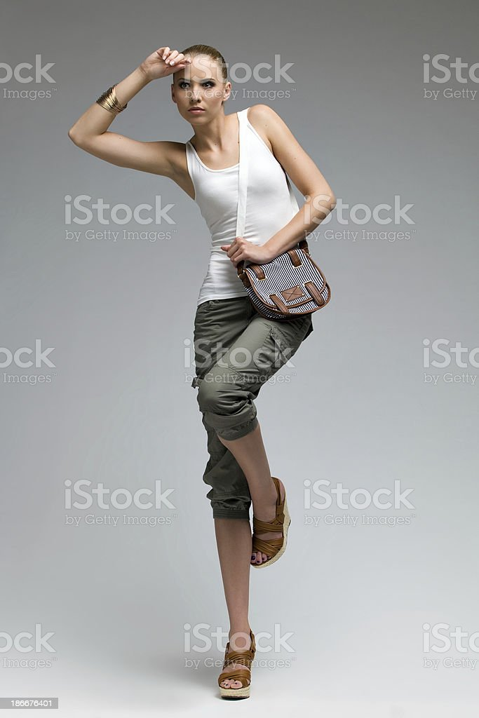Beautiful fashion model posing on one leg. stock photo