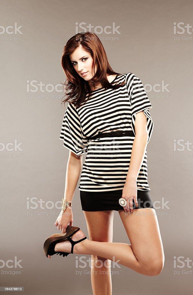 Beautiful fashion model posing with one leg up royalty-free stock photo