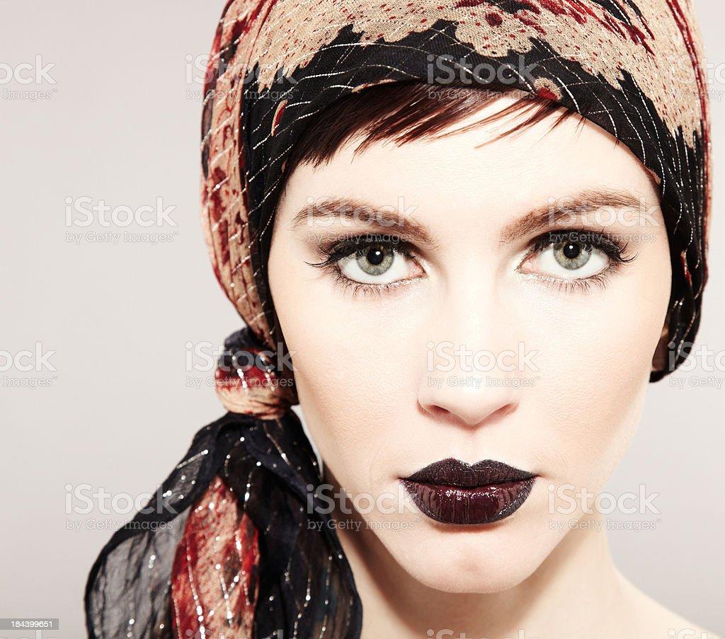 Beautiful fashion model wearing headscarf and black lipstick stock photo