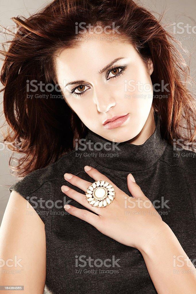 Beautiful fashion model wearing large ring posing for camera royalty-free stock photo