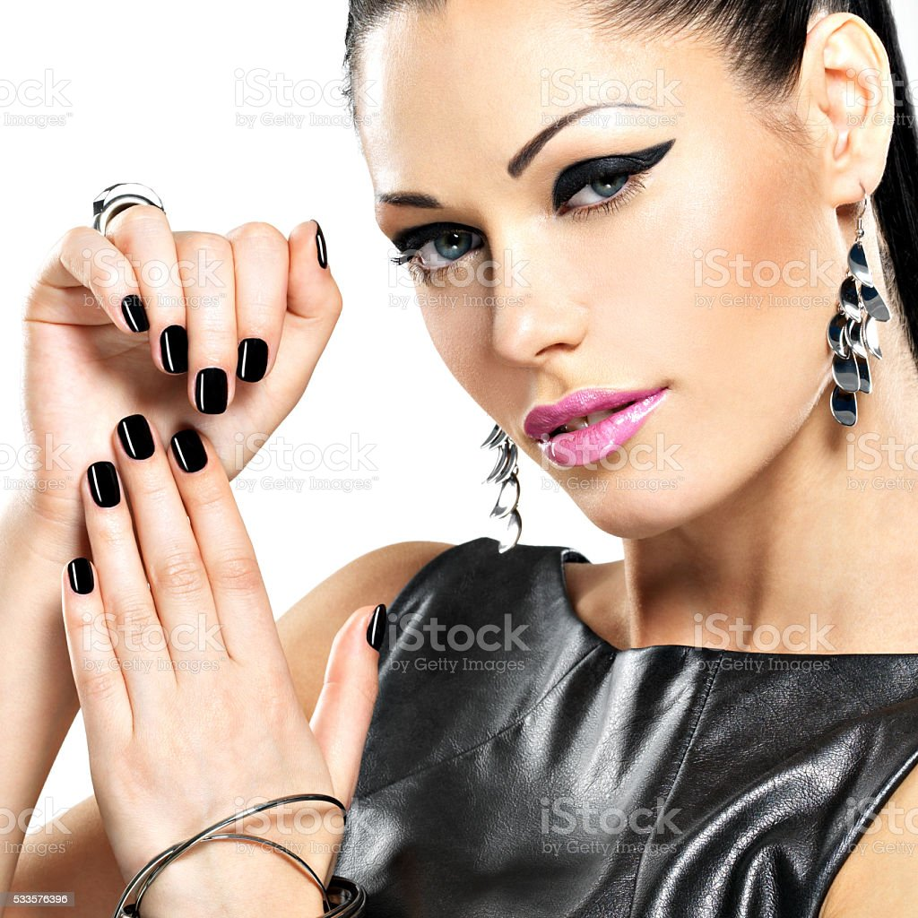 Beautiful fashion sexy woman with black nails at pretty face stock photo