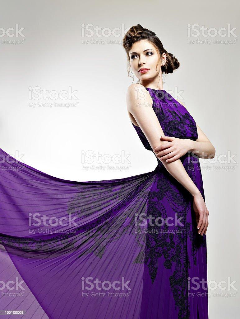 Beautiful fashion woman in violet long dress royalty-free stock photo