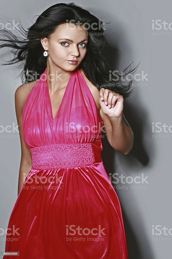 Beautiful fashionable sexy woman in red dress stock photo