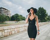 Beautiful fashionable woman in black