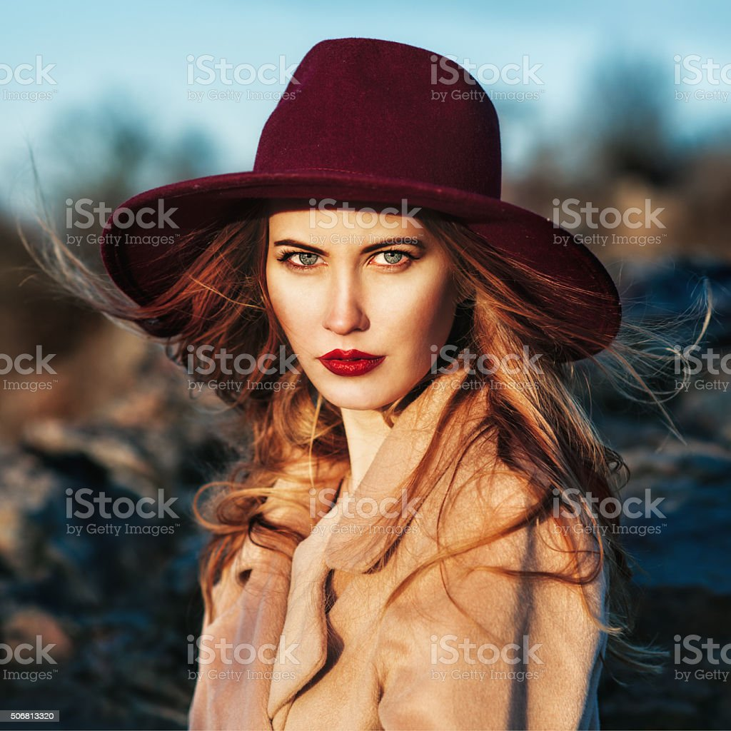 beautiful fashionable woman wearing red hat stock photo
