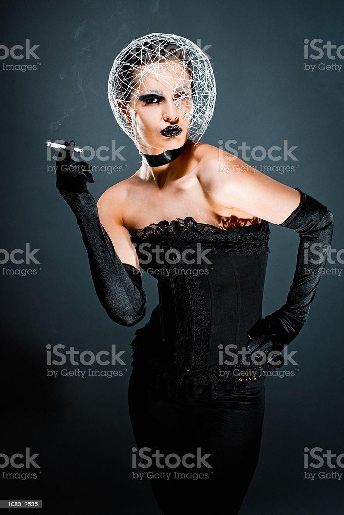 Beautiful Fashionable Young Woman smoking royalty-free stock photo