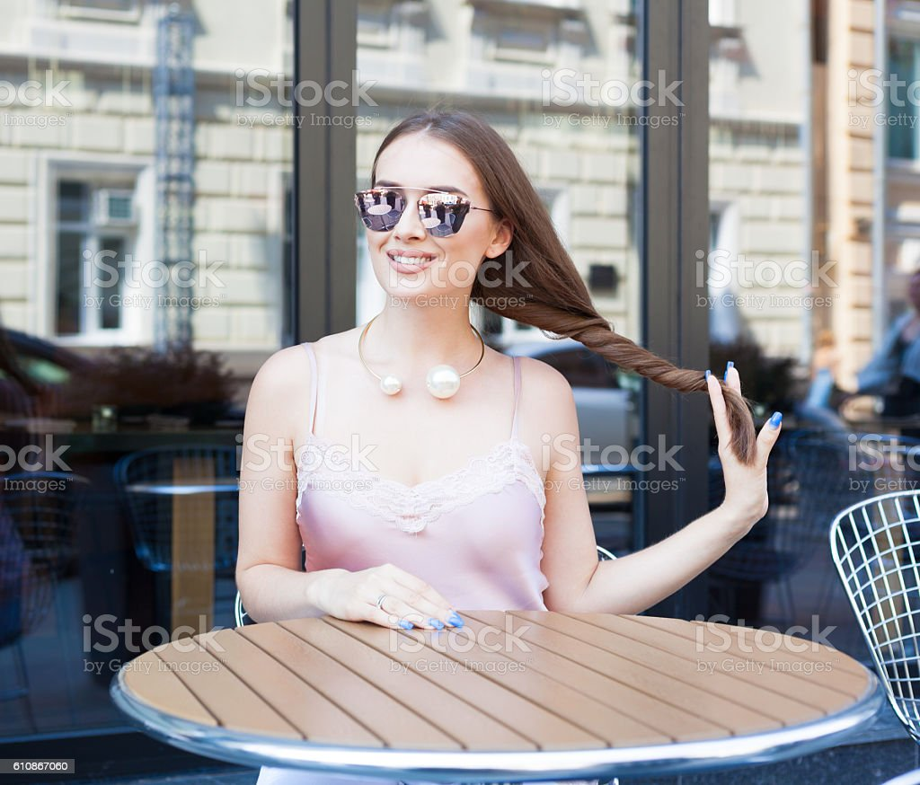 Beautiful fashionably dressed young woman with long dark hair stock photo