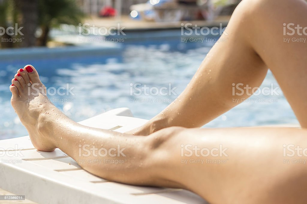 Beautiful Feet and toes by the swimming pool stock photo