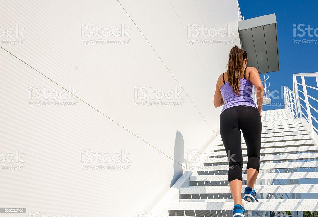 Beautiful female athlete running stock photo