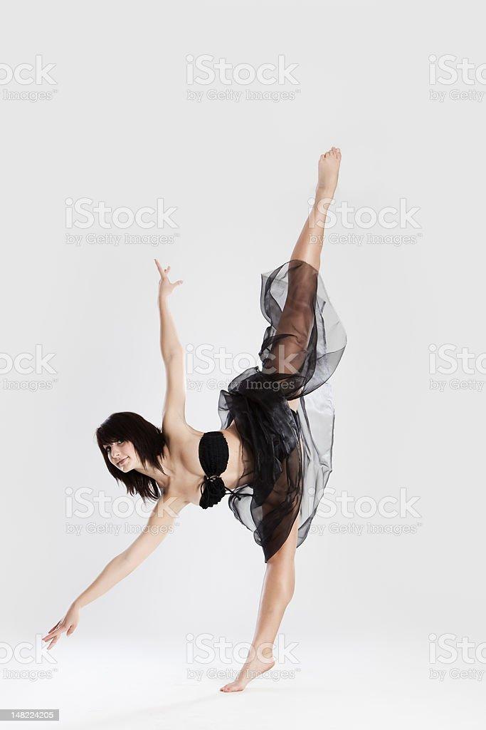 Beautiful female ballerina doing split royalty-free stock photo
