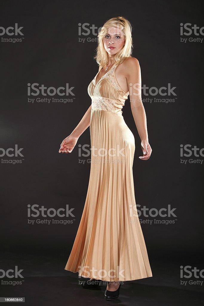 Beautiful female blonde fashion model in yellow dress royalty-free stock photo