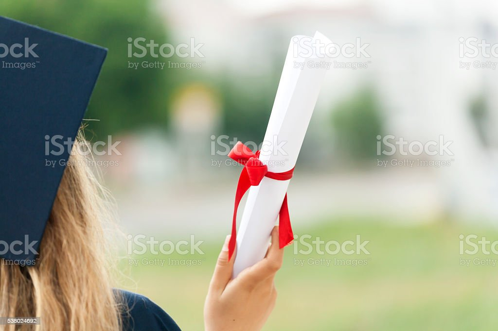 Beautiful Female College Graduate Holding Diploma stock photo