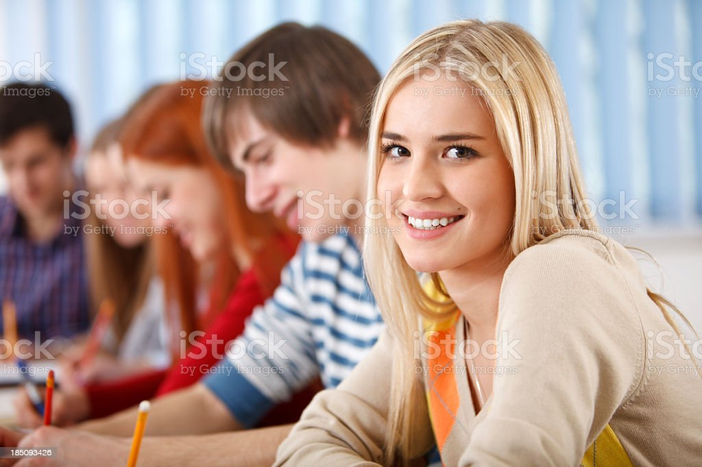Beautiful female college student smiling in the classroom royalty-free stock photo