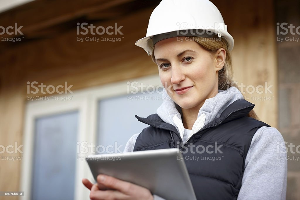 Beautiful female construction engineer using tablet pc royalty-free stock photo