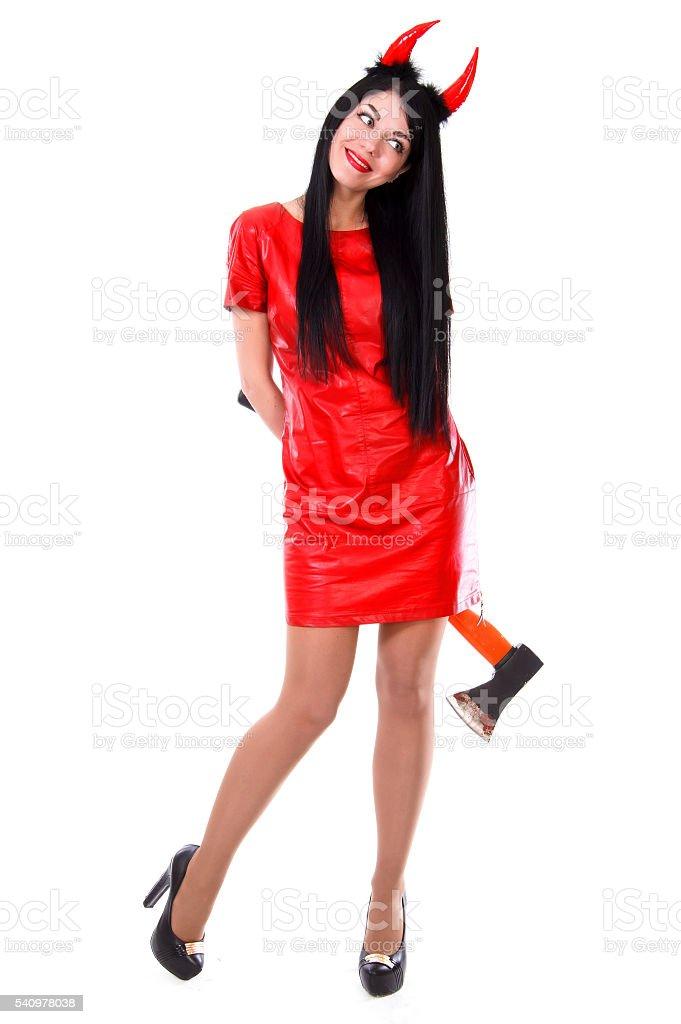 Beautiful female demon holding an axe stock photo