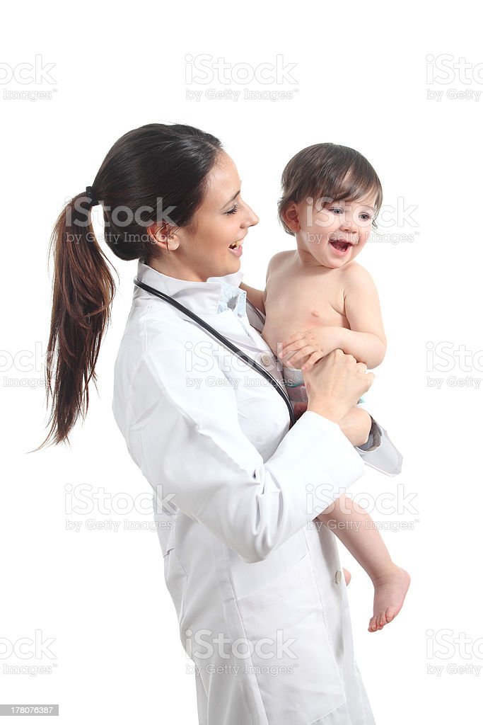 Beautiful female doctor holding a baby royalty-free stock photo