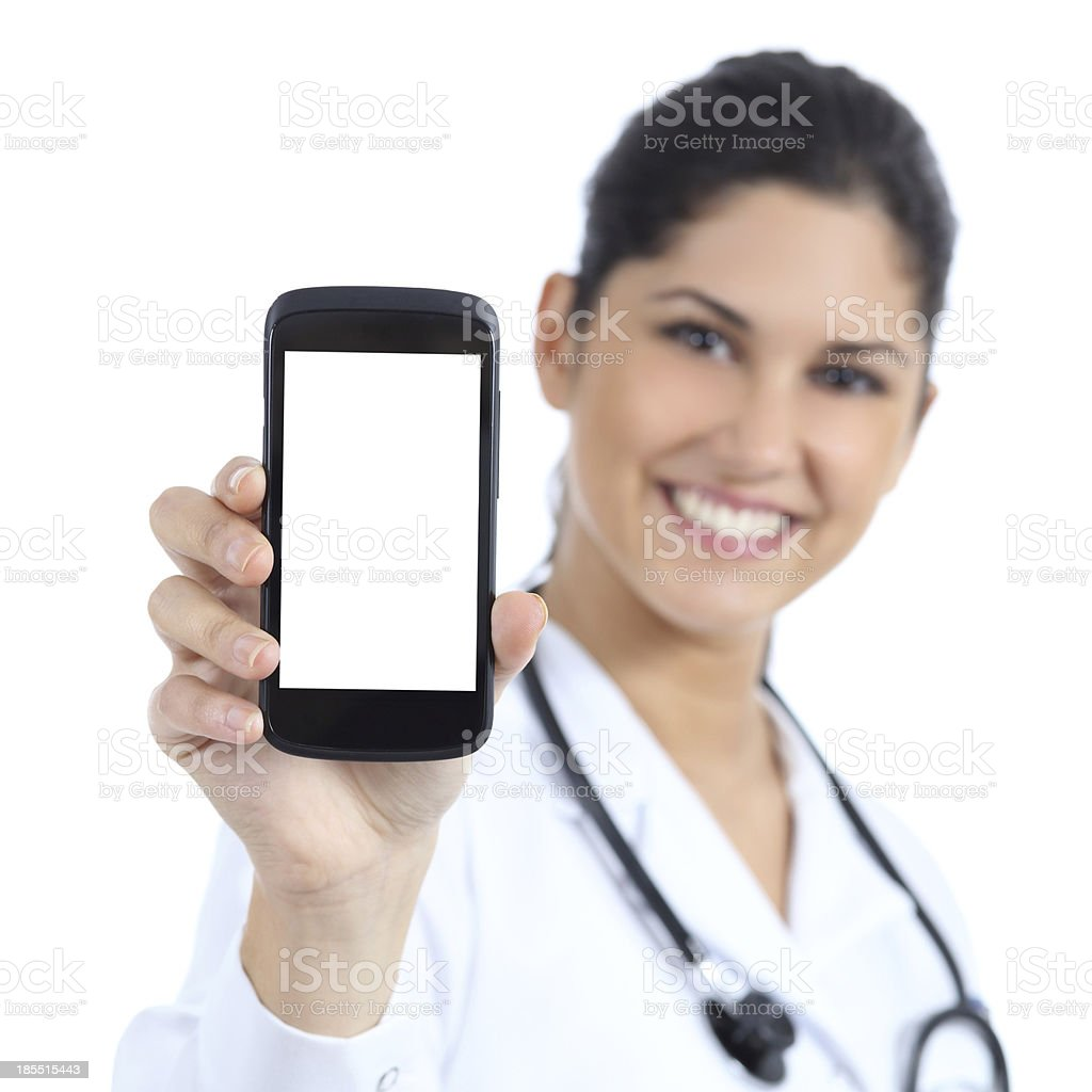 Beautiful female doctor showing a blank smart phone screen royalty-free stock photo
