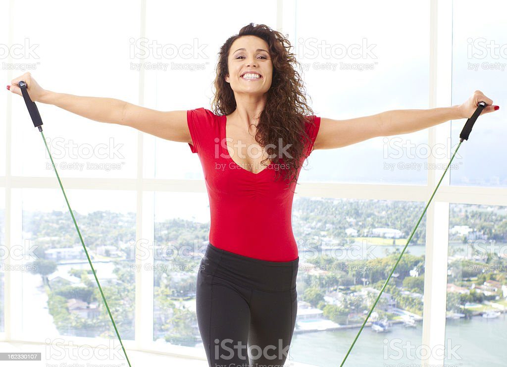 Beautiful Female Doing Resistance Training stock photo